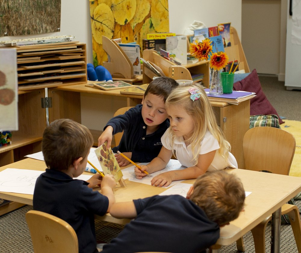 Early Childhood students working in small groups to learn about master artists such as Van Gogh.