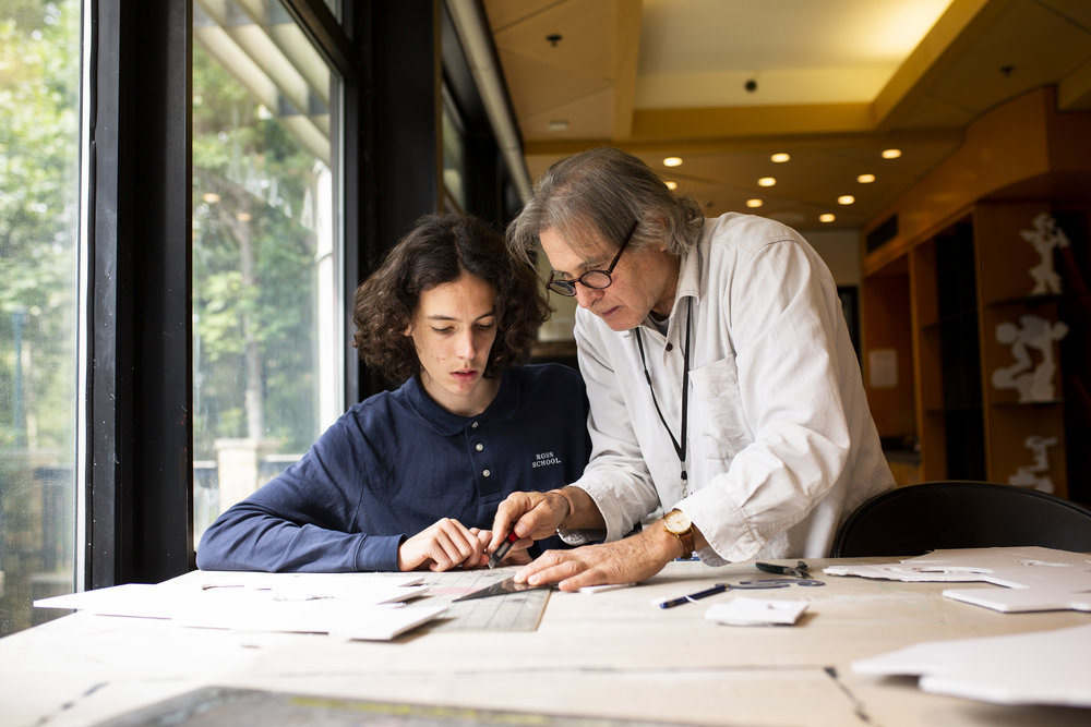 Well-known sculptor and Ross School art teacher Ned Smyth works with an upper school art student.