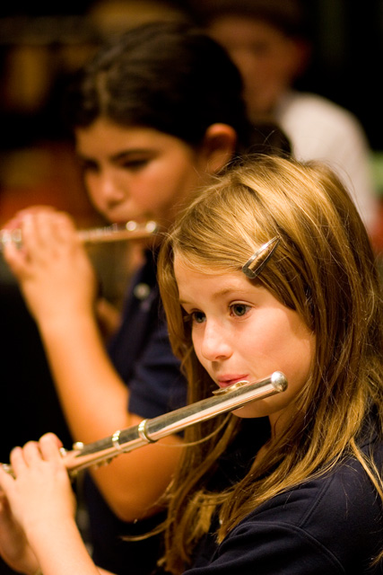 Ross Elementary student playing the flute. Music, Visual Arts, Wellness and other specials classes integrate and augment the curriculum.