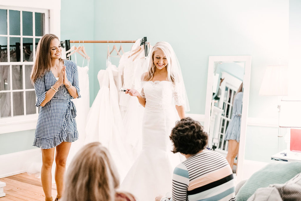 Kandyce Montgomery ringing the bell after deciding on 'her dress' for our shoot! Photo: Katey Keeton