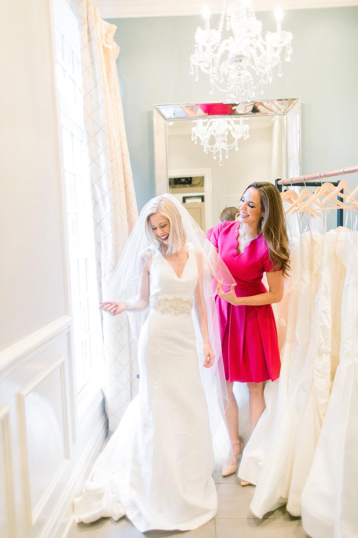 Amanda Turner choosing the Elizabeth Anne with Gena Lee belt and swarvarski crystal veil. Photo by Taylor Yaste