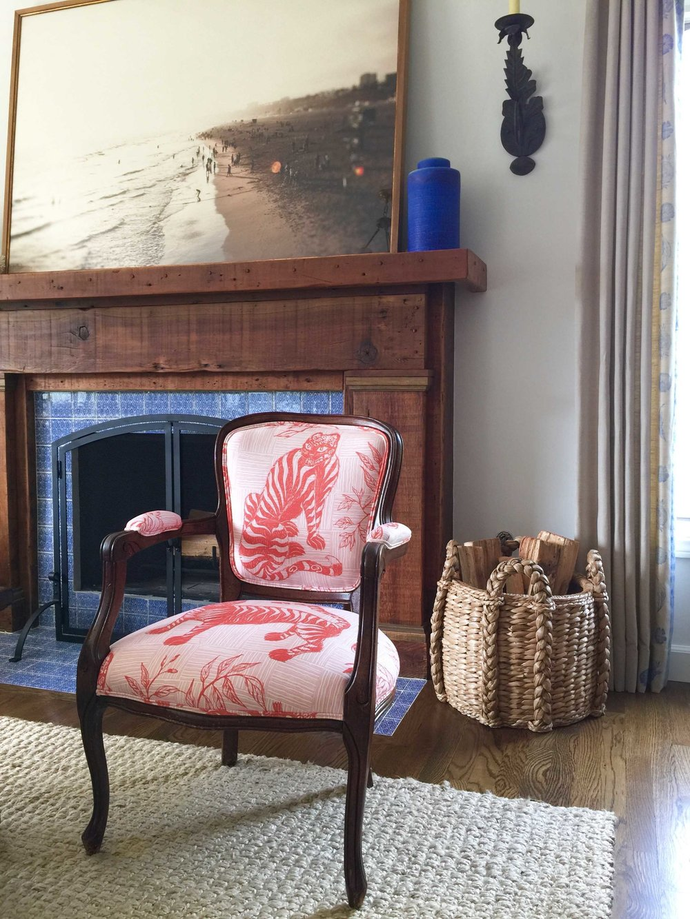 Tiger & Magpie Fabric in Carmine on a chair  Photo by Karyn Millet