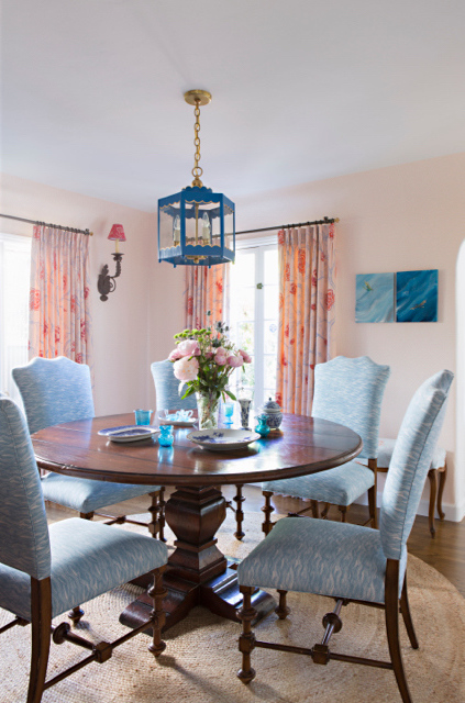 Painted Wave in Lake on the dining chairs, Peony Forest in Rose as curtains  Photo by Karyn Millet