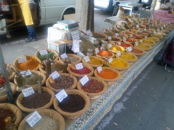 Spice vendor at the farmers market in Arles, France