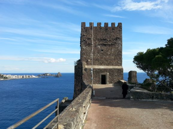 Norman castle in Aci Castello, Catania, Scily, Cyclopean Isles in the background