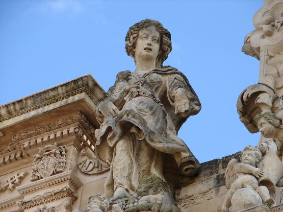 One of hundreds of beautifully carved statues at the Chiesa de Santa Croce in Lecce, Italy.