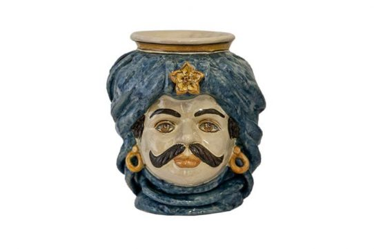 Ceramic head by Giacomo Alessi. Note the Arab influence common in Sicilian ceramics.