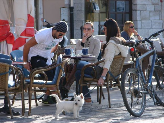 Some friends enjoying coffee and conversation at a cafe in Rovinj