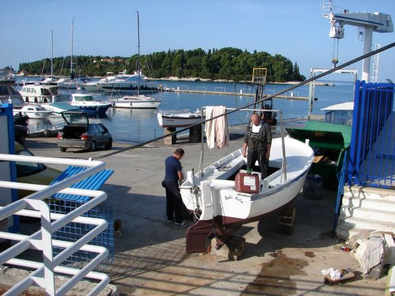 Workers prepping a boat near the harbor in Rovinj