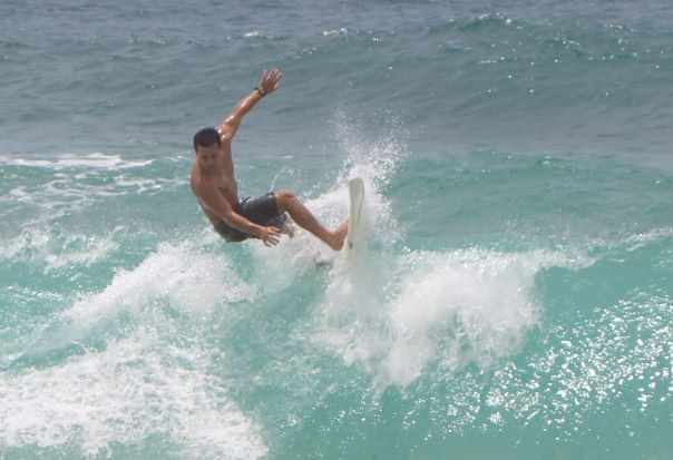 Surfer taking on the Banzai Pipeline