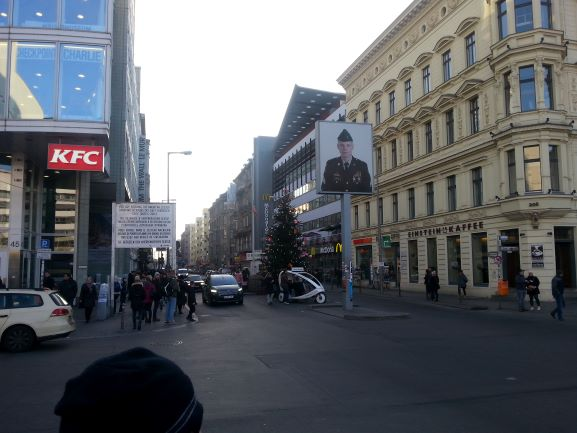 Berlin's notorious Checkpoint Charlie is now a tacky tourist trap with KFC and Mickey D's nearby.