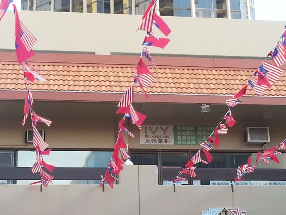 Flags of the U.S. and Taiwan flying at the Chinatown Cultural Plaza, Honolulu