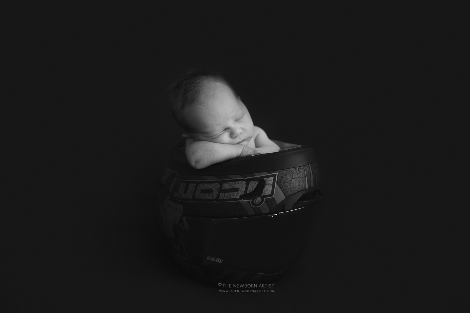 newborn baby in motorcycle helmet