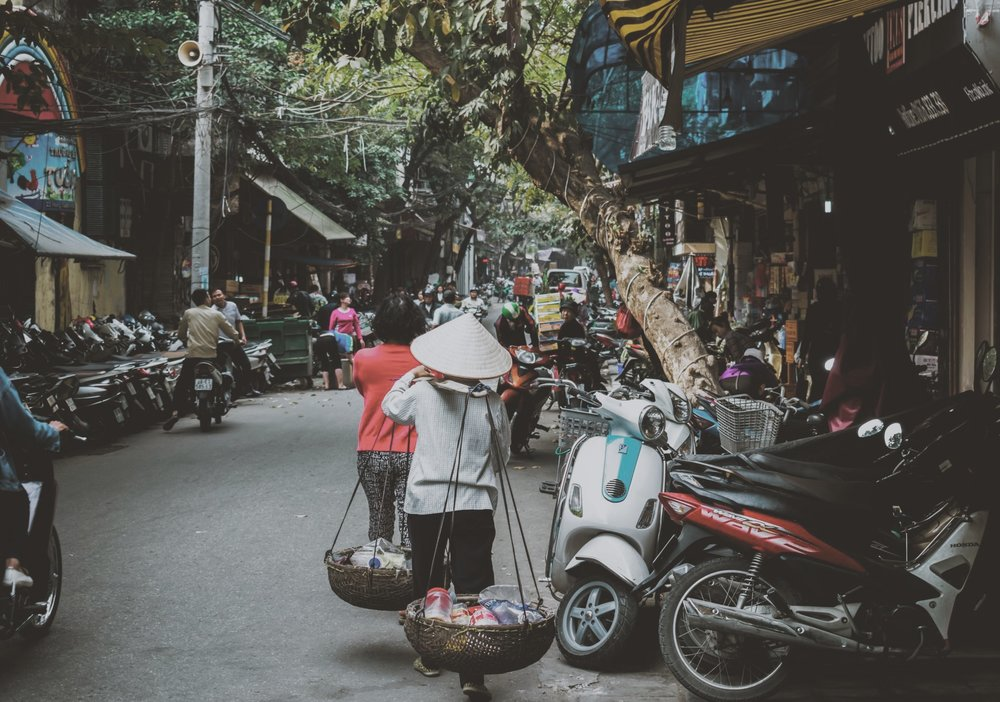 Women bring produce from their farms to sell in Hanoi. Photo by    Son Vu Le    on    Unsplash   .