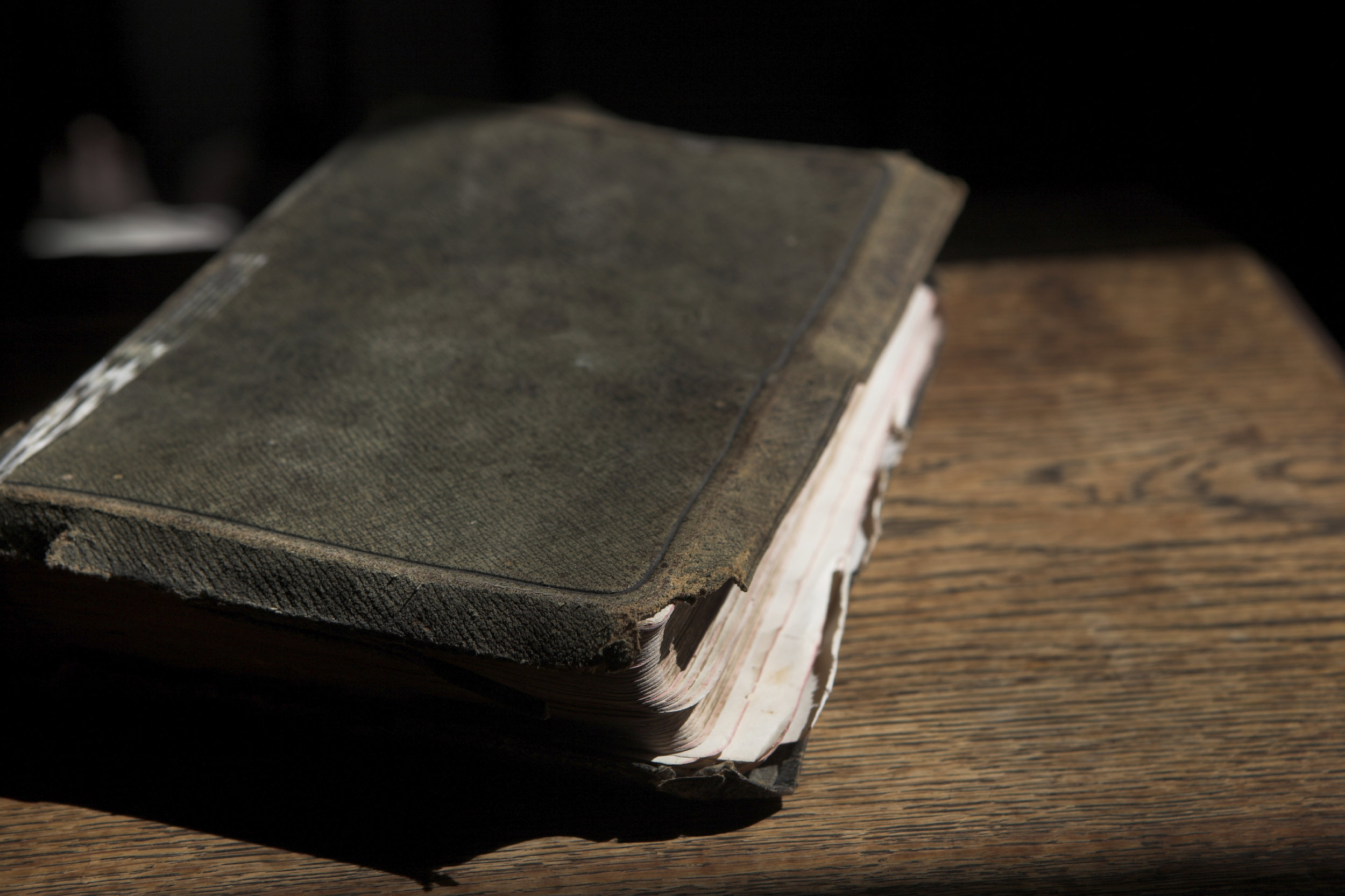 Leather covered bible lying on a table
