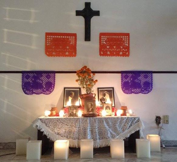 Altar with sugar skulls, marigolds and candles