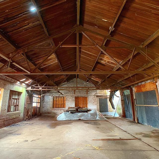 Things are coming together with our #NewHavenClockFactory project. It's amazing how much larger a space looks when it's not filled with barrels and debris. #architecture #affordablehousing #newhaven #clockfactory #restoration #rehabilitation #historicpreservation #whatanarchitectdoes