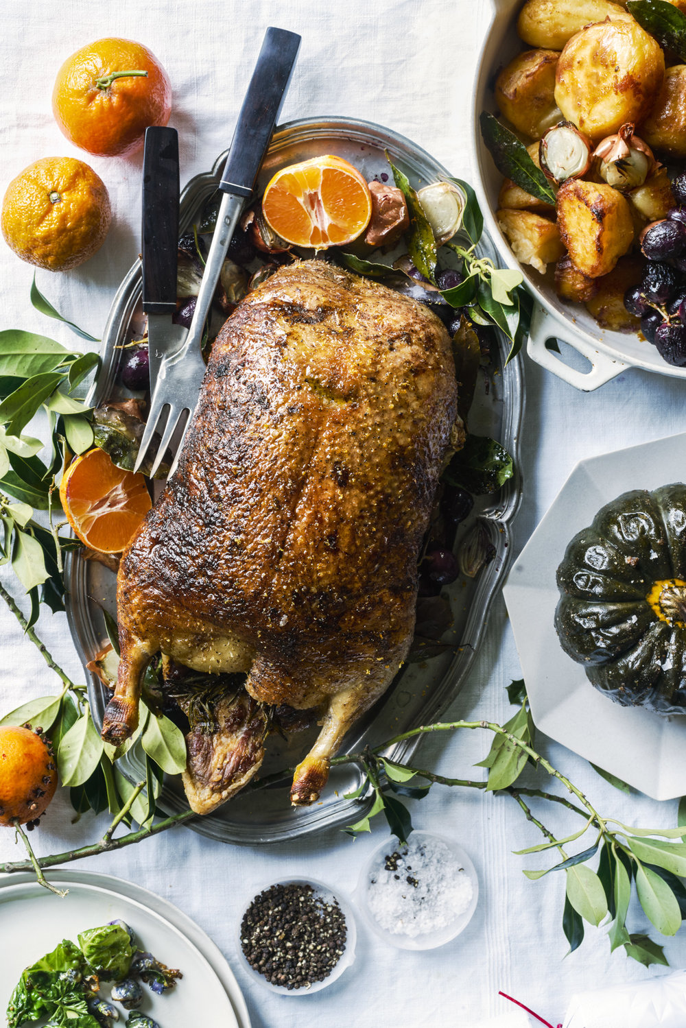 Roast Rosemary and orange roasted duck with duck fat confit & roasted potatoes