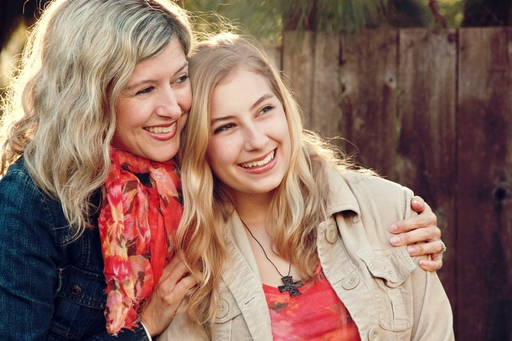 Mother and Daughter embracing Christian Stock Photos.jpg