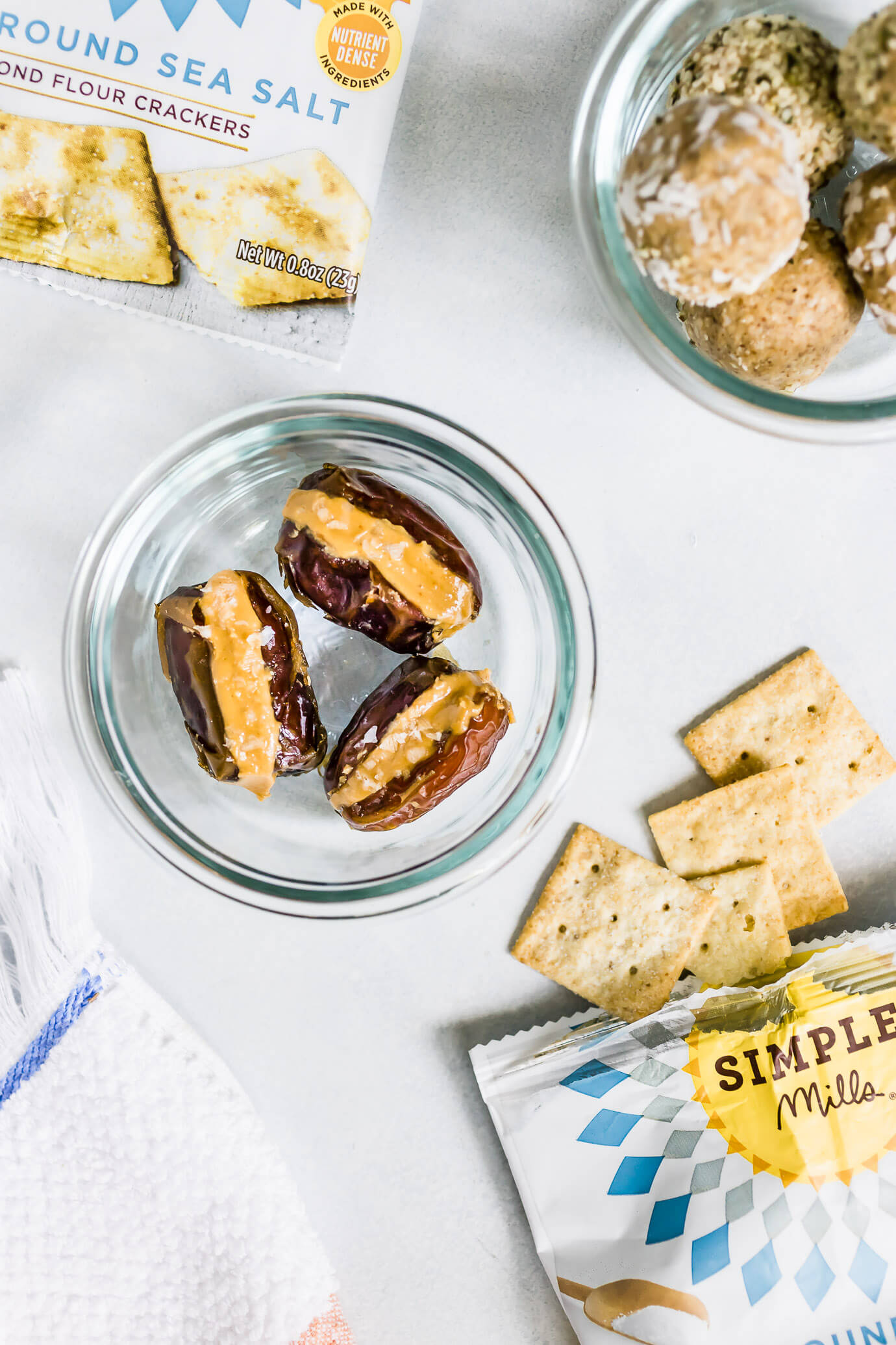5 Simple Healthy Snacks for Summer featuring Simple Mills Almond Flour Crackers, peanut butter stuffed dates and cashew coconut snack bites