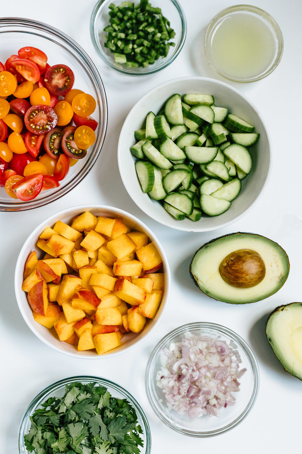 A fresh summer salad full of late summer produce - tomatoes, peaches, and cucumbers. Serve this Spicy Tomato Peach Salad as is or make it an entree by adding protein and more healthy fat.
