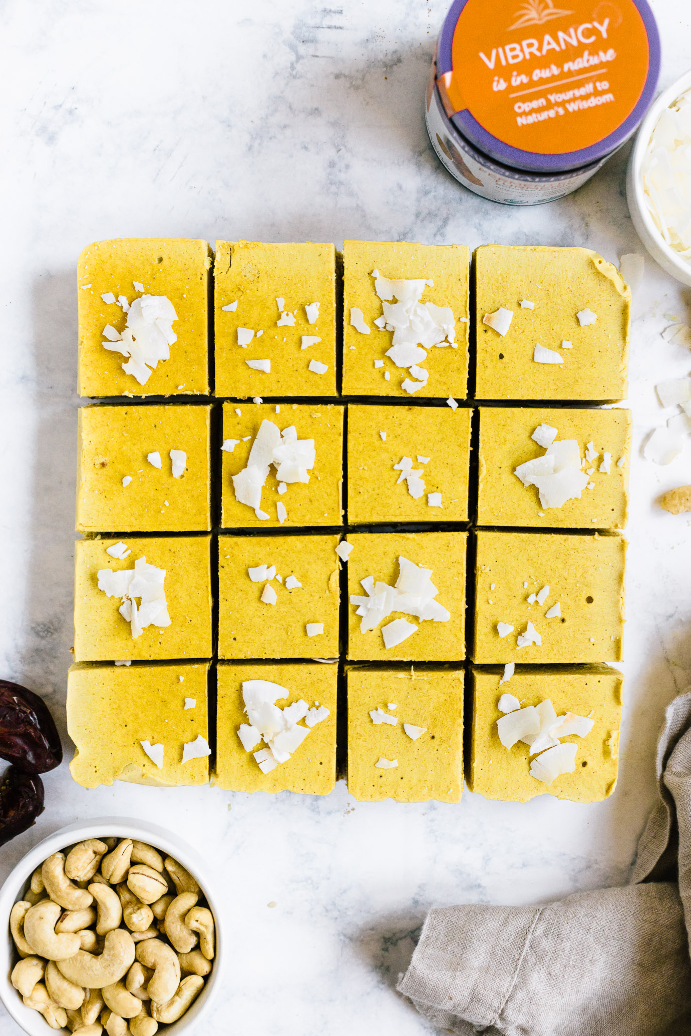 Sliced Golden Milk Cheesecake Bars with New Chapter Turmeric Booster