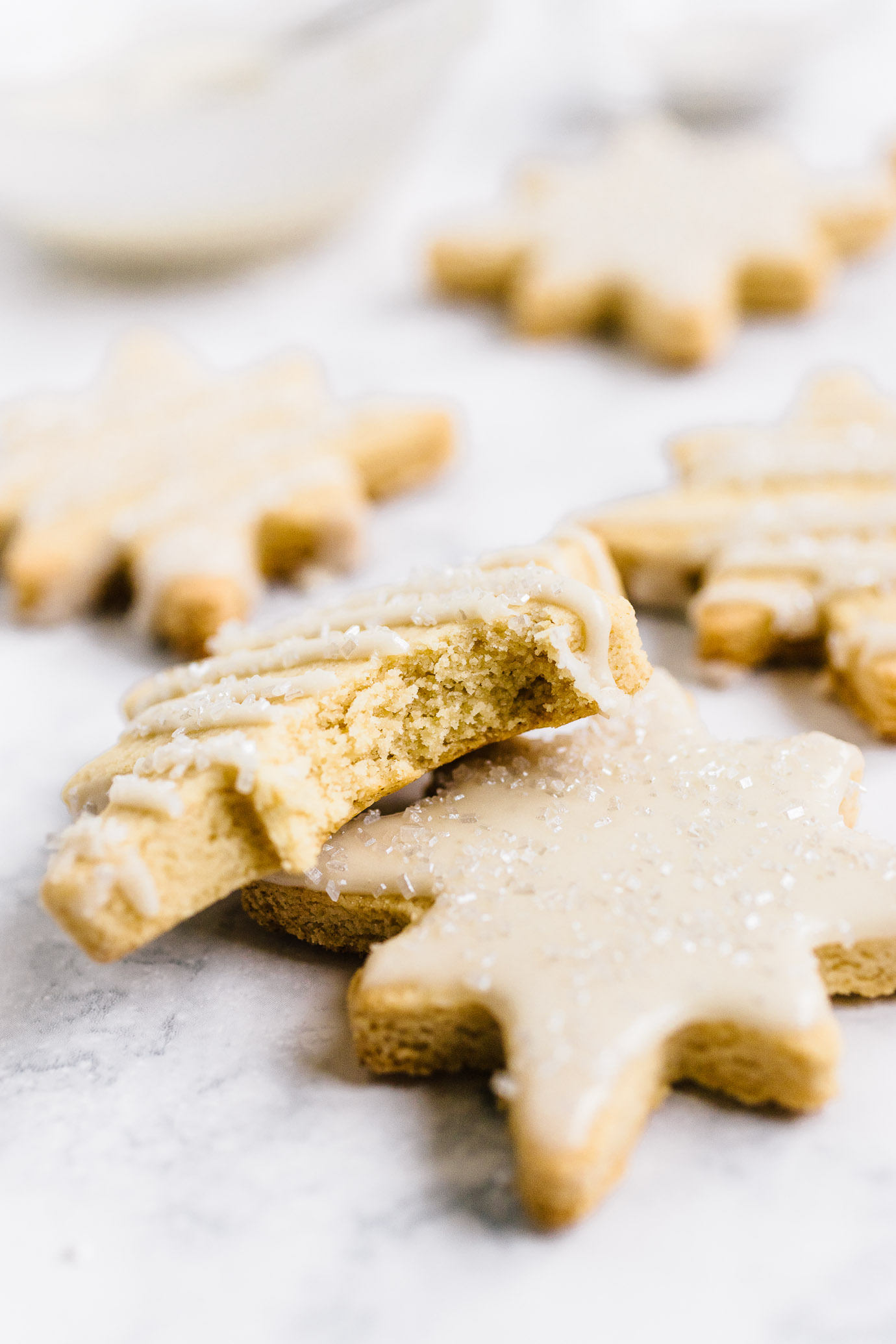 close up of iced plate of iced Almond Flour Sugar Cookies cut-outs