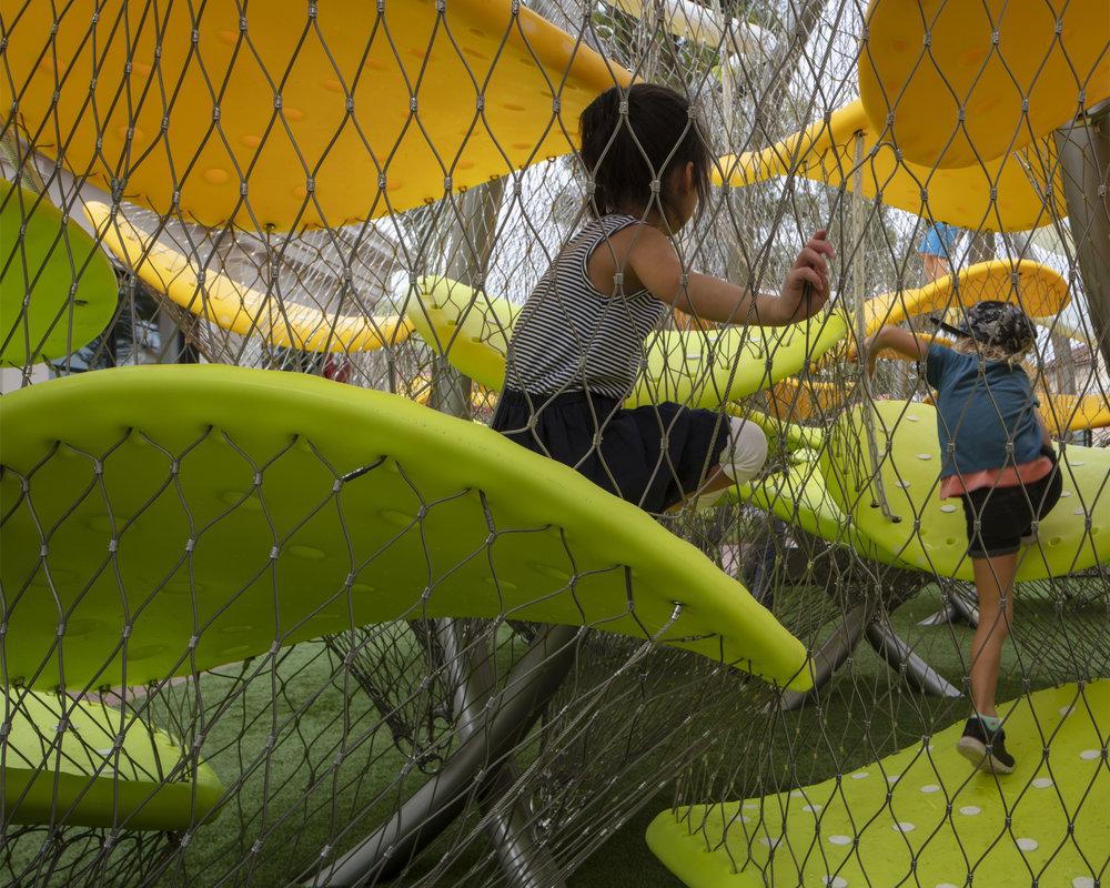 Kids climbing the Luckey Climber at  Irvine Spectrum Center .
