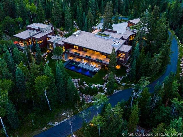 2470 W White Pine Lane - MLS: 11900224 | List Price: $16,450,0004 Bedrooms | 6 Bathrooms | 10,286 SQ FTThoughtfully conceived as a place of refuge & family gatherings, this timeless contemporary residence elevated high above natural grade, provides 360 degree unobstructed Iron Mountain, ski run & down valley views. A desired open floor plan featuring organic materials sets the tone for a peaceful & intimate living experience where the outdoor is welcomed in at every turn. A ski easement provides direct, quick access to Tombstone lift where ski lovers can enjoy first powder runs at the Canyons.