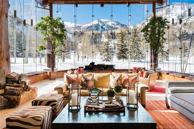 69 White Pine Canyon Road - MLS: 11704333 | List Price: $14,950,00014 Bedrooms | 22 Bathrooms | 33,000 SQ FTThe location gives it best ski access in Park City, with direct access to 9990 & Peak 5, plus 20 lockers to hold winter gear. This 14 bedroom home has space for everyone, the remarkably lit great room boasts 30-ft windows and the large living spaces sprawled throughout the home make it a perfect place for families to gather. This epic ski lodge has all the amenities you can think of and more, take a dip in the spa, warm up in the sauna or steam shower, grab a bottle of wine from the cellar and sit down to a movie in the theater.