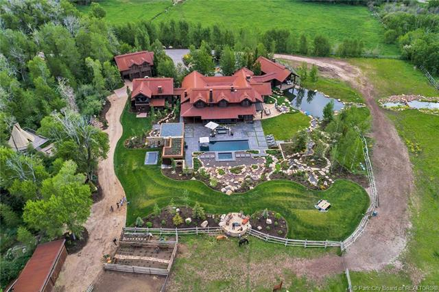 1401 W Two Creeks Circle - MLS: 11808376 | List Price: $14,900,0006 Bedrooms | 10 Bathrooms | 8,503 SQ FT Designed by Costantino Grandjacquet and built by Jim Clifford, the mostly single level living home frames views of all 3 ski resorts through floor-to-ceiling windows from its 7 flat acres, complete with a new pool, 3 ponds and waterfall, barn, horse arena, and guesthouse right in the heart of town. Finishes such as an indoor bridge over water, hand crafted ski lockers, custom stone, concrete floors and Venetian plaster complement luxuries such as a wine cellar, and theatre room.