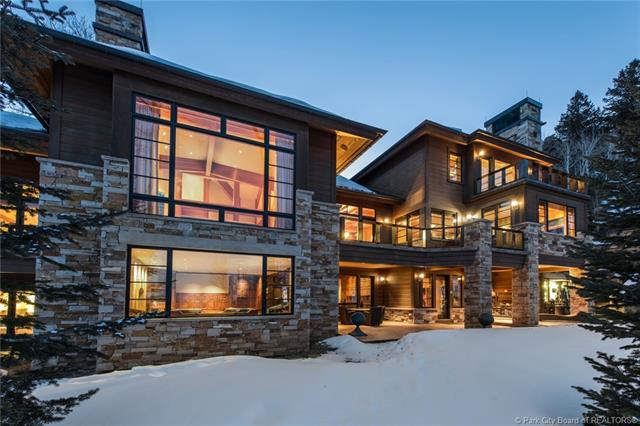 74 White Pine Canyon - MLS: 11801548 | List Price: $12,900,0007 Bedrooms | 9 Bathrooms | 18,500 SQ FTA mountain estate with over 18,000 sq ft nestled on almost 7 acres in a private, gated community. Easy ski-in/ski-out access from your home directly onto Another World. Added bonus of an attached guest wing with a kitchenette, 3 en-suite bedrooms, and bunk room that sleeps 6. Indoor, 25 meter pool with a waterfall, steam room, sauna and Jacuzzi. The main home has 3 spacious bedroom suites, a fitness room, theatre room, 2 wine rooms, elevator, chef's kitchen, huge butler's pantry and 6-car garage. The living room has vaulted ceilings and limestone fireplace with the finest down valley views in The Colony.