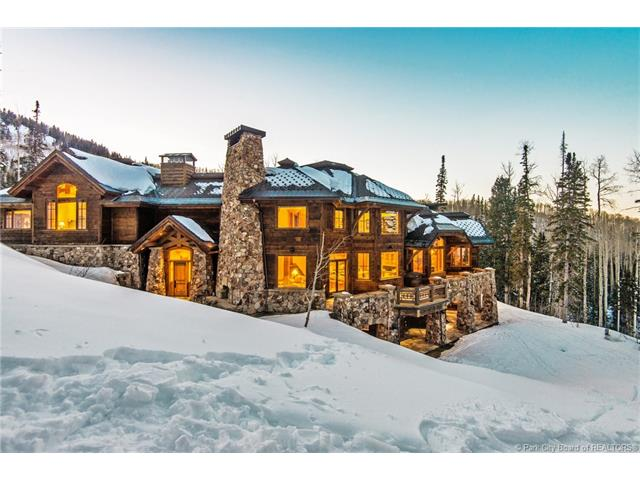 91 White Pine Canyon Road - MLS: 11700206 | List Price: $10,900,0009 Bedrooms | 12 Bathrooms | 14,384 SQ FTThis deluxe 8.5 acre, ski-in/ski-out estate is located in the prestigious gated community of The Colony. A stunning sky bridge entry leads to the gorgeous master bedroom with private deck and spectacular views of White Pine Canyon. The upper west wing encompasses four en-suite guest bedrooms. The lower level family room features entertainment for everyone bunk room for the kids, pool table, bar, wine cellar and theatre room. The gorgeous 3,700 sq ft guest house includes master suite, two guest suites, gourmet kitchen, heated RV garage and additional two-car garage. Ski access below Dreamcatcher Lift. Landscaping includes natural spring and waterfall emptying into a pond.