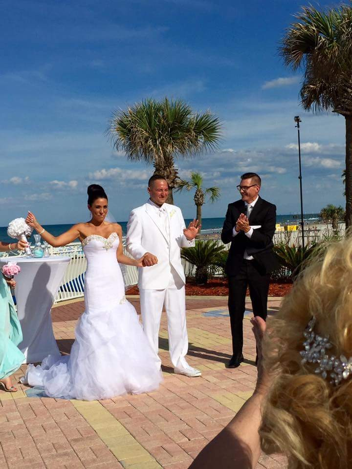 Sam applauds Newlyweds after providing officiant services in Daytona Beach