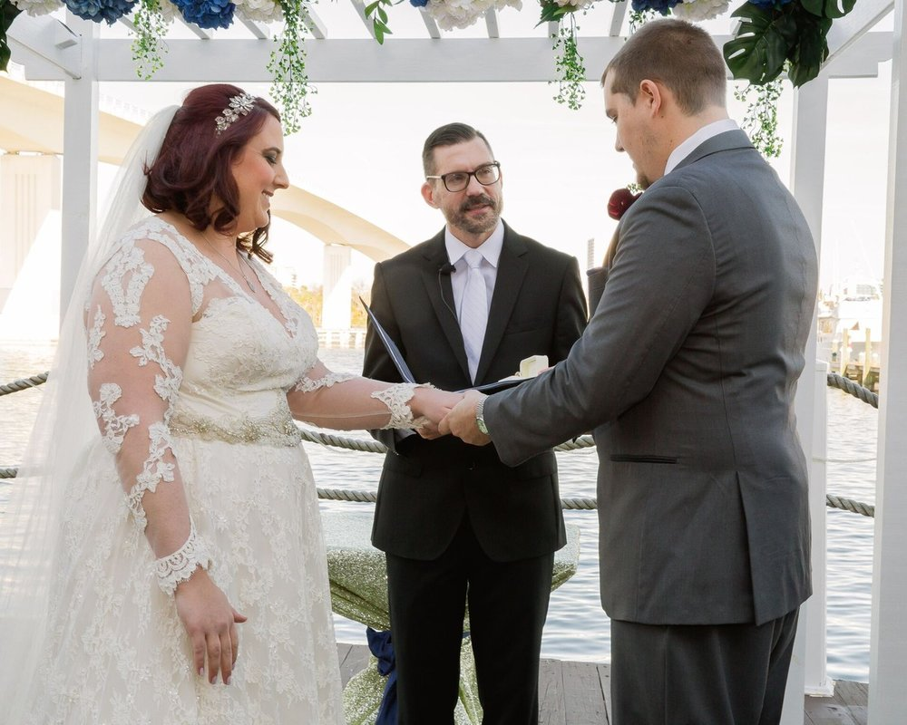 Sam officiates a personalized wedding ceremony with couple overlooking lake in Daytona Beach