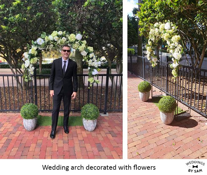 Wedding arch decorated with flowers - Weddings by Sam.jpg