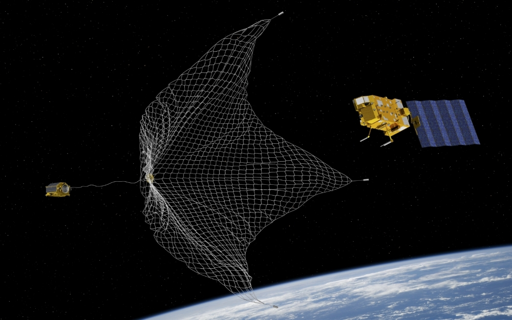 ESA e.Deorbit system study - capturing a satellite with a net and tether. Credit: ESA