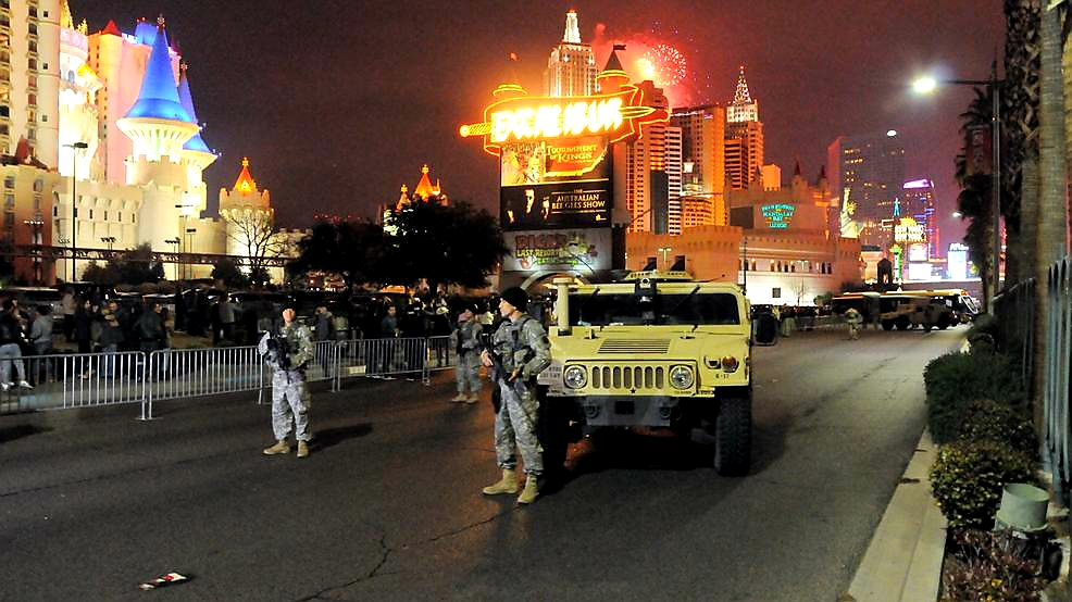 Nevada Army National Guard keep watch as fireworks go off in the background during the 2017 New Year's celebration on the Las Vegas Strip. The Soldiers are working with the Las Vegas Metropolitan Police Department in an exercise to defend a possible attack aimed towards the Las Vegas Strip and innocent civilians. (Army photo by Sgt. Walter H. Lowell, 17th Sustainment Brigade, Nevada Army National Guard)