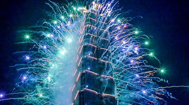 Taipei 101 lit up with fireworks and animation for New Year's Eve celebration that takes place every year.