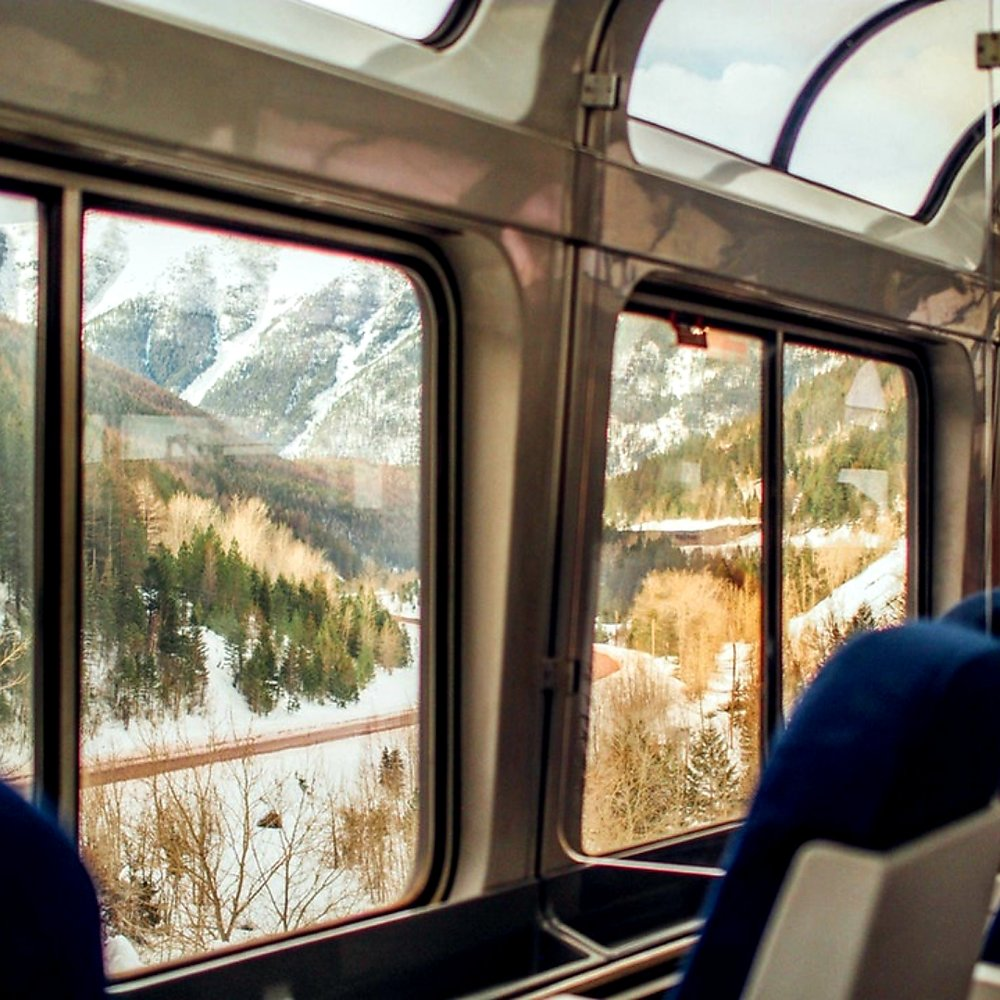 Amtrak's observation car with floor-to-ceiling windows and mesmerizing views. Photo: Spark Post.