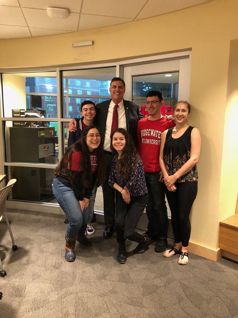 President Clark poses with students. (Fack row left to right: Nick Jordan, President Fred Clark, Sean Meehan, Alyssa Raymond Front row, left to right: Mia Sarkisian, Heather McKenna. Photo credits: Matt Rau)