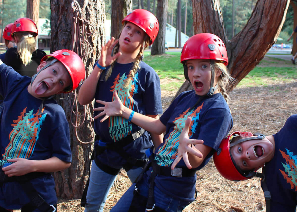 Students embarking on a high ropes adventure course at Hume Lake Christian Camps