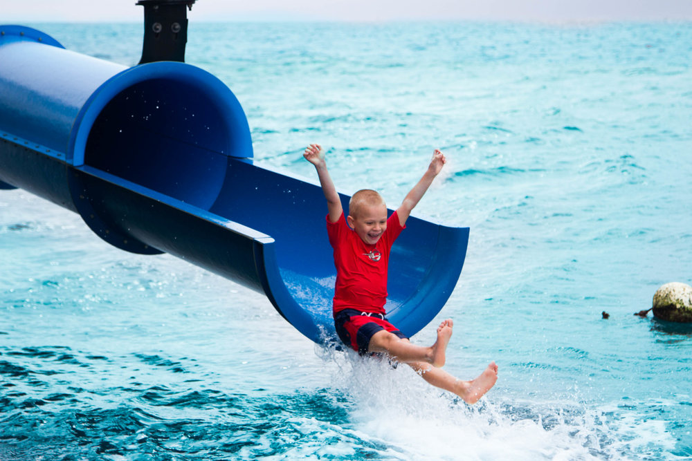 child on Moore Reef water slide.jpg