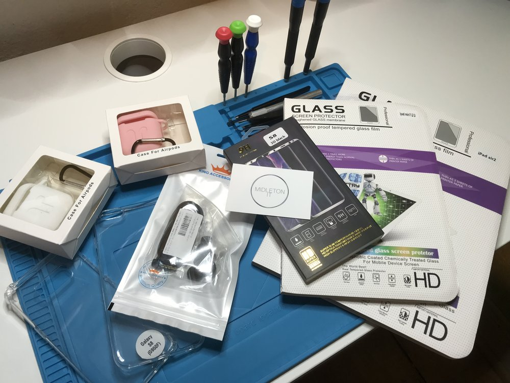 ASSORTMENT-OF-PHONE-AND-GADGET-ACCESSORIES-ON-A-TABLE.JPG