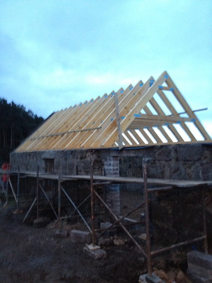 start of roof being built on steading