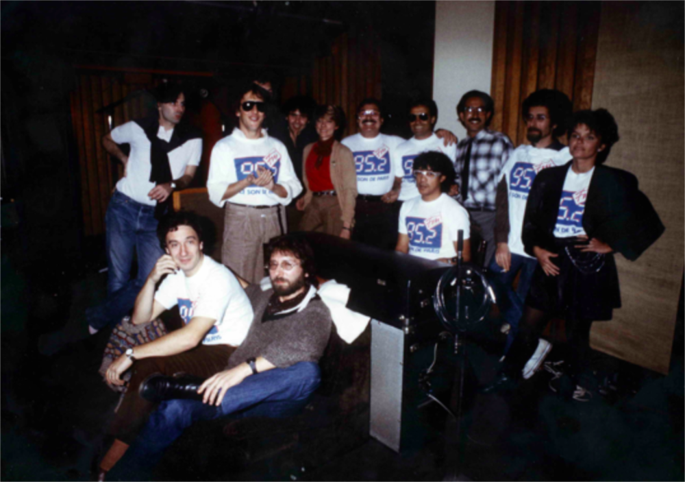 Creating the jingle package for the young radio station FM 95.2 with a group of formidable representatives of what French music and songs was at that time.At the Gang studio, starting from the left: Olivier di Spirito Santo, Gilbert Montagné, Marc Tobali, Christian Schaeller, Choueka [1] , Fr David, Laurent Voulzy, Alexandre Marcellin, Jean Schulteis, Diane Tell, Michel Bernhole.