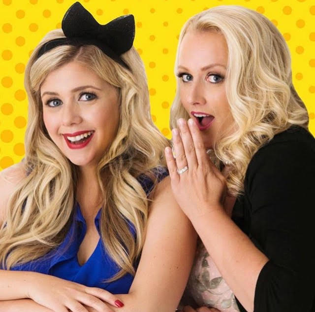 two blonde women share the secret life of weddings podcast in front of yellow pop art