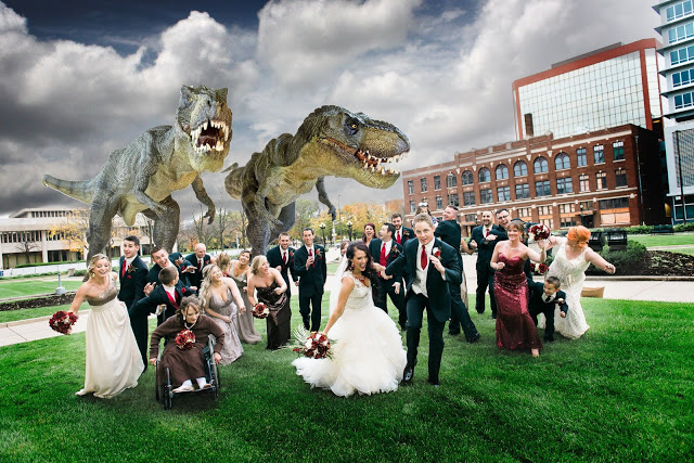 a wedding party runs away from two dinosaurs, one girl is in a wheelchair