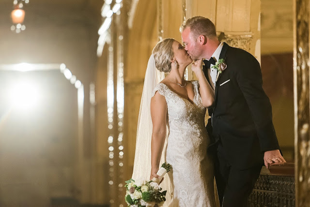 blonde bride and groom kiss in yellow room at embassy theater