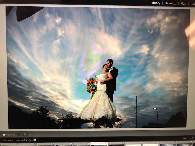 cell phone photo of a photo being edited in lightroom